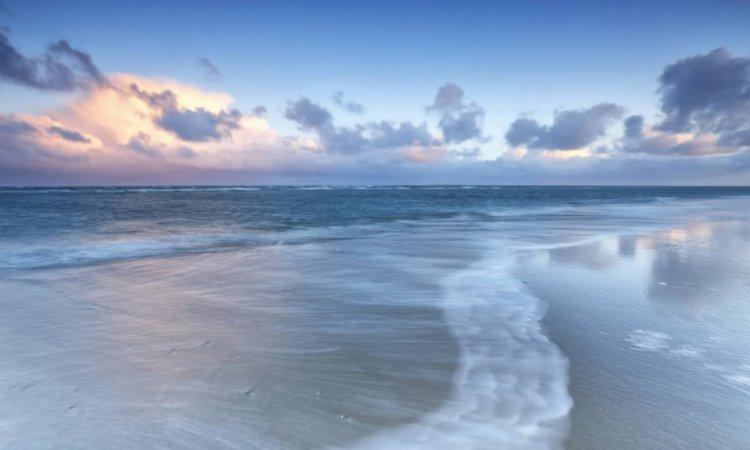 blurred wave on north sea coast at sunrise