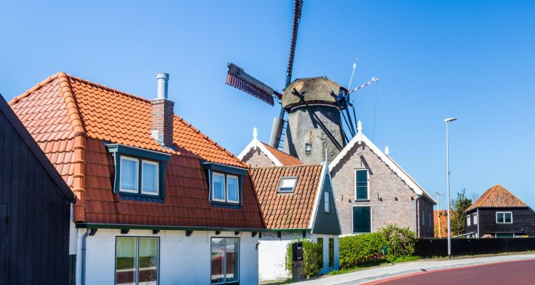 Village Oudeschild with windmill and trraditional fisherman houses on Texel island in the Netherlands