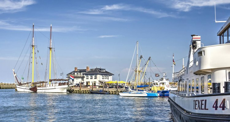 Island of Texel, The Netherlands, July 21, 2018: Several boats and yachts in the harbour of Oudeschild on a sunny summer day
