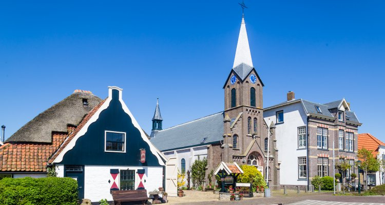 Village Oudeschild with Martinus church and trraditional gable  houses on the Wadden island Texel in the Netherlands