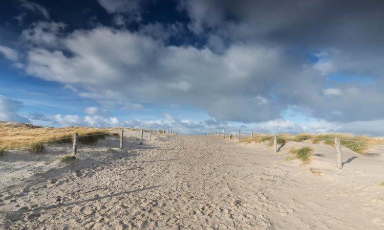 path on sand and beaufirul blue sky, Texel, Netherlands